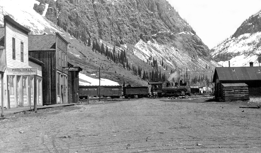 Downtown Eureka's main street in the 1920s with a Silverton Northern train that has just crossed the Animas River headed to Silverton.