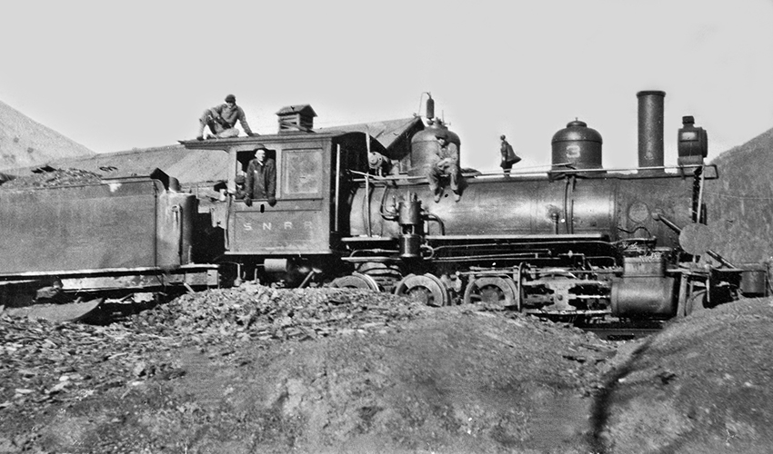 Silverton Northern Railroad locomotive #3, with tender, standing on siding south of Silverton Northern Machine Shop.